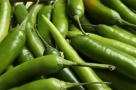 Ripe green chili peppers as background, closeup Stock Photo