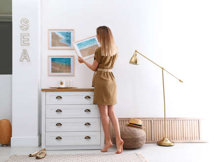 Young interior designer at work in modern room