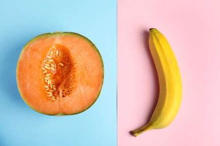 Flat lay composition with fresh banana and melon on color background. Sex concept