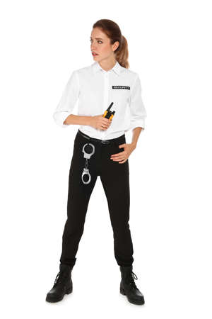 Female security guard in uniform with portable radio transmitter on white background Stockfoto - 130121873