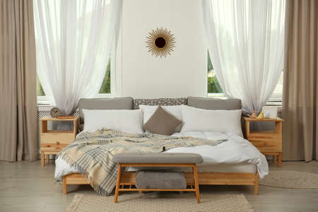 Stylish modern room interior with comfortable bed Stock fotó