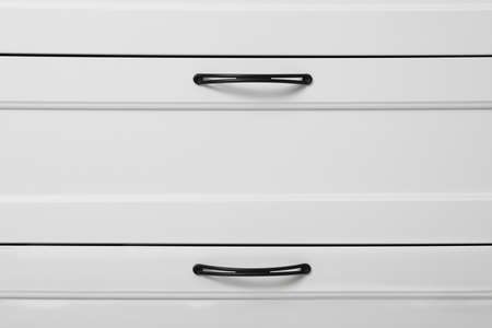 Modern white chest of drawers as background 스톡 콘텐츠