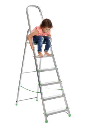 Little girl sitting on ladder on white background. Danger at home