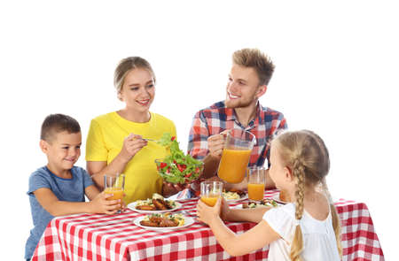 Happy family having picnic at table on white background Archivio Fotografico - 129915083