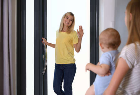 Mother leaving her baby with teen nanny at home