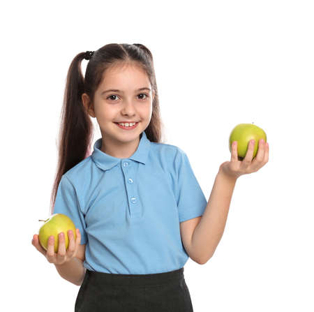 Little girl holding apples on white background. Healthy food for school lunch Stock Photo