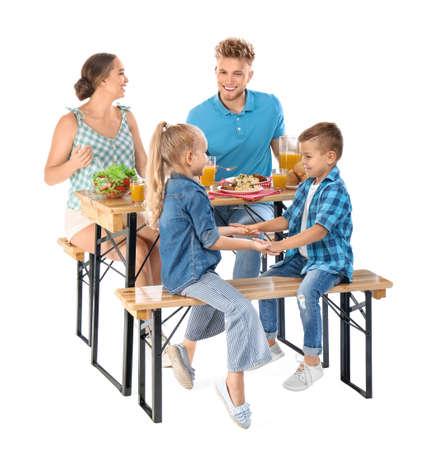 Happy family having picnic at table on white background Archivio Fotografico - 129919325