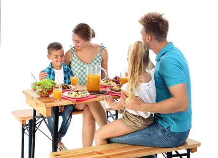 Happy family having picnic at table on white background Archivio Fotografico - 129919326
