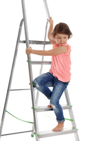 Little girl climbing up ladder on white background. Danger at home