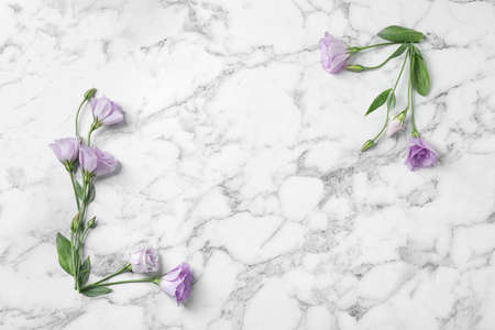 Flat lay composition with beautiful Eustoma flowers on marble table, space for text Stock fotó