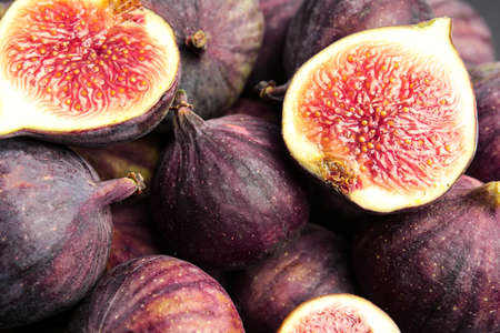 Tasty ripe fig fruits as background, closeup