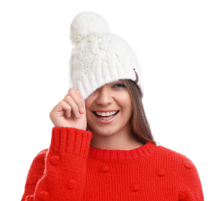 Young woman in warm sweater and hat on white background. Winter season Фото со стока