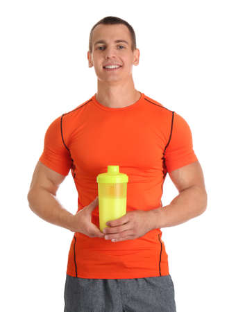 Athletic young man with protein shake on white background Imagens