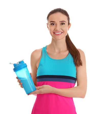 Athletic young woman with protein shake on white background