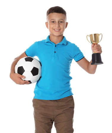 Happy boy with golden winning cup and soccer ball on white background