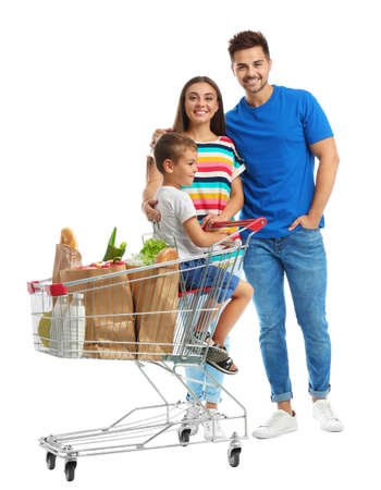 Happy family with shopping cart on white background