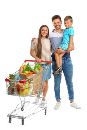 Happy family with full shopping cart on white background