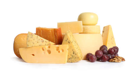 Composition with cheese, grapes and walnuts on white background