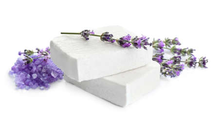 Hand made soap bars with lavender flowers and bath salt on white background