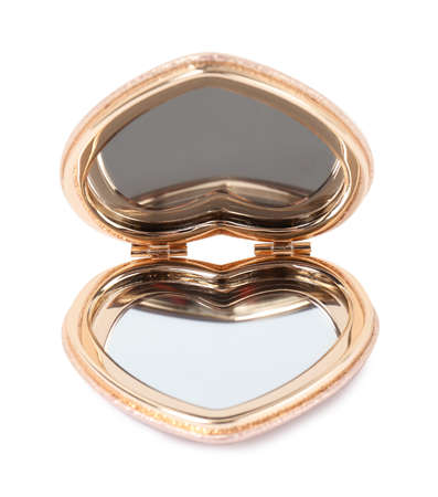 Stylish gold pocket mirror on white background