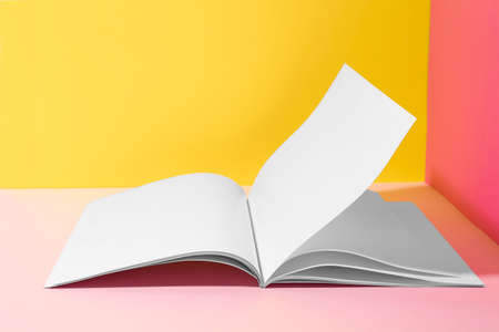 Empty book pages on color background. Mockup for design