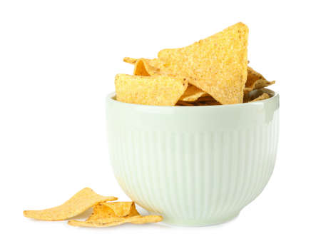 Bowl with tasty Mexican nachos chips on white background Фото со стока