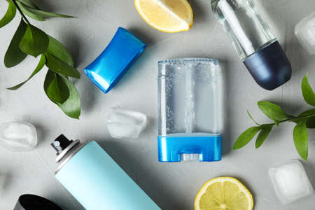 Flat lay composition with different natural deodorants on grey table