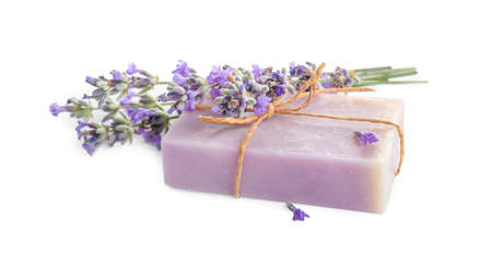Hand made soap bar with lavender flowers on white background 写真素材