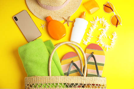 Flat lay composition with beach objects on yellow background Reklamní fotografie - 129794055