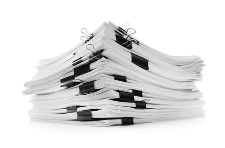 Stack of documents with black paper clips on white background