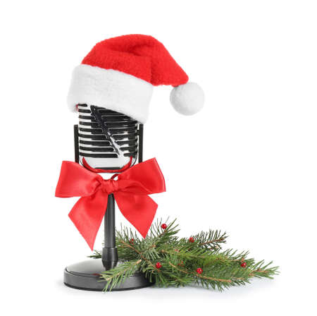 Retro microphone with Santa hat isolated on white. Christmas music concept Stock Photo