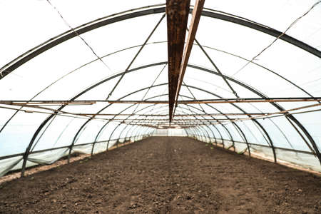 Large agricultural greenhouse prepared for seed sowing 写真素材