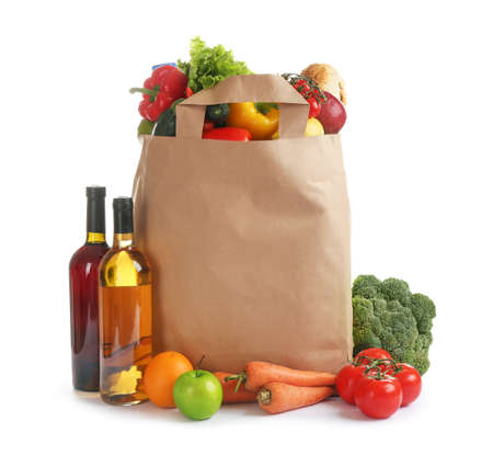 Paper bag with different groceries on white background 写真素材