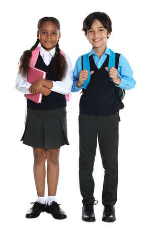 Happy children in school uniform on white background