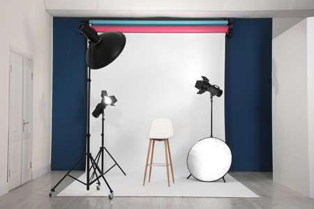 Photo studio interior with set of professional equipment Stok Fotoğraf - 129795983