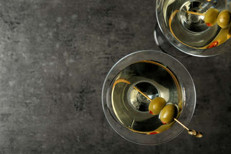 Glasses of Classic Dry Martini with olives on grey table, flat lay. Space for text Stock fotó