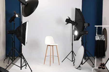 Photo studio interior with set of professional equipment Stok Fotoğraf - 129738539