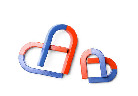 Red and blue horseshoe magnets on white background, top view Stok Fotoğraf