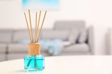 essential oil on table in room. Space for text Stock Photo