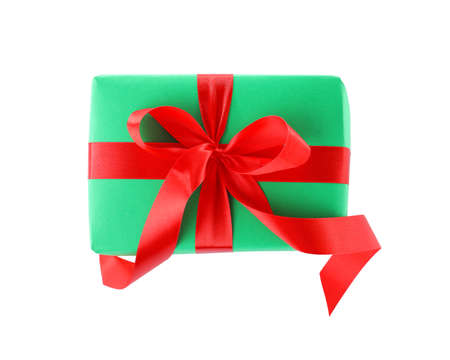 Christmas gift box decorated with ribbon bow on white background, top view 写真素材