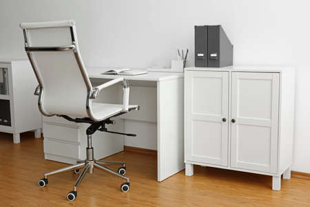 Stylish workplace interior with modern office chair and desk Banco de Imagens