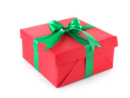 Christmas gift box decorated with ribbon bow on white background