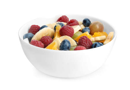 Fresh tasty fruit salad on white background