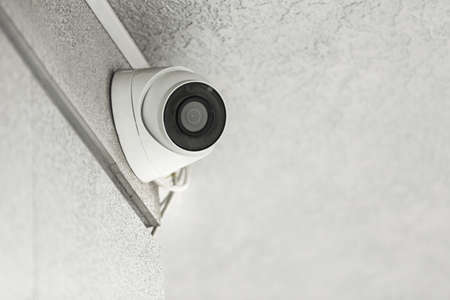 Modern CCTV security camera on building outdoors. Space for text Stockfoto