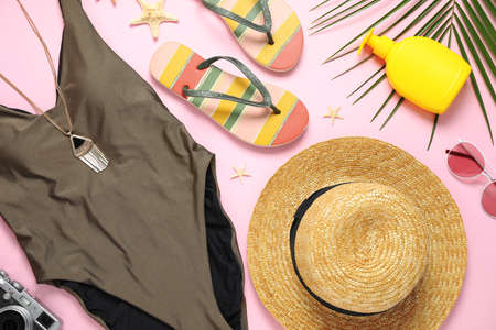 Flat lay composition with beach accessories on pink background 스톡 콘텐츠