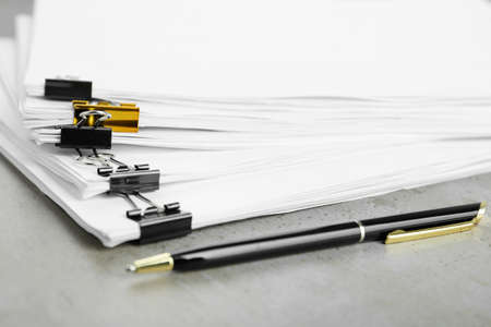 Stack of documents with binder clips on light table, closeup 版權商用圖片