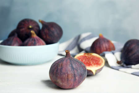 Tasty ripe figs on white wooden table. Space for text 写真素材