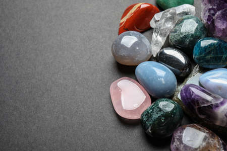 Flat lay composition with different gemstones on dark table, space for text Zdjęcie Seryjne