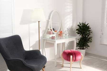 Stylish room interior with elegant dressing table Stock Photo