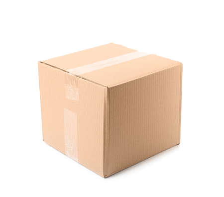 Closed cardboard box on white background. Mockup for design Stock Photo